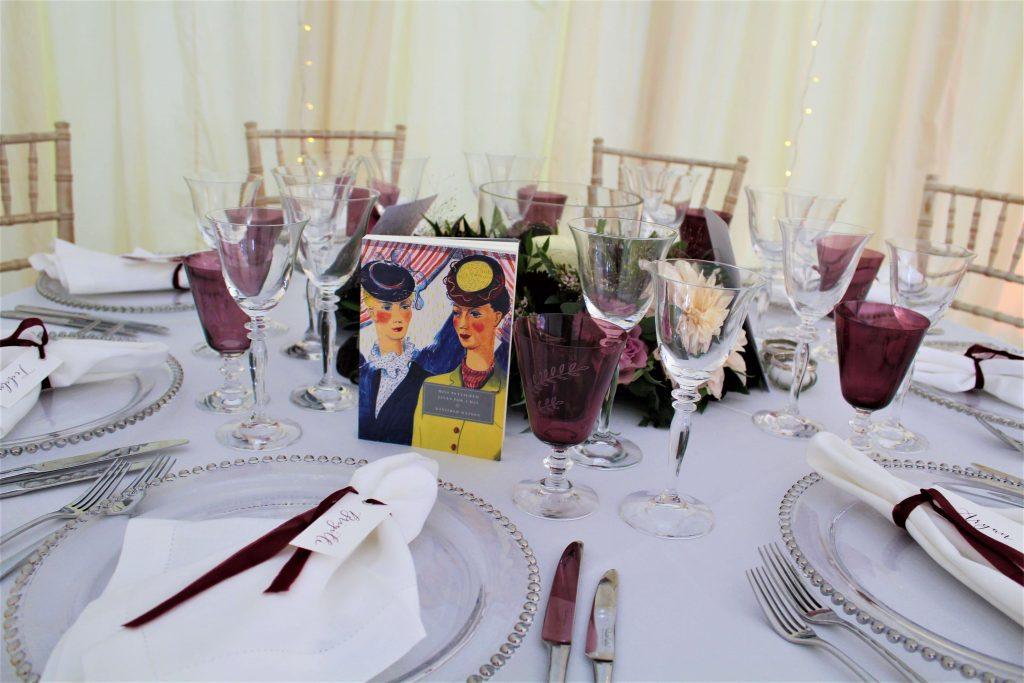 marquee wedding table naming using books