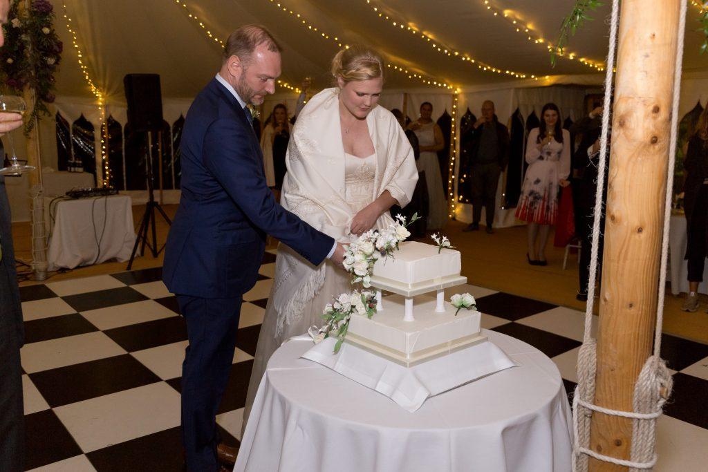 marquee wedding cutting cake