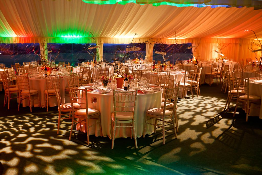 wedding marquee with tables chairs and lights