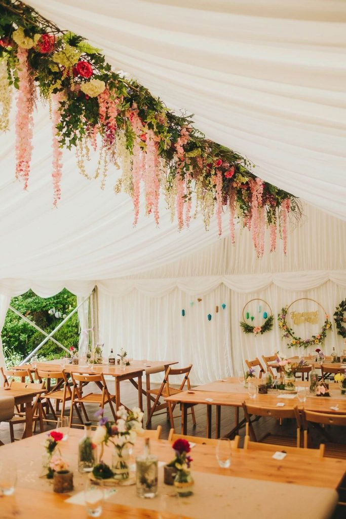 Floral hanging installation in wedding marquee for marquee decoration