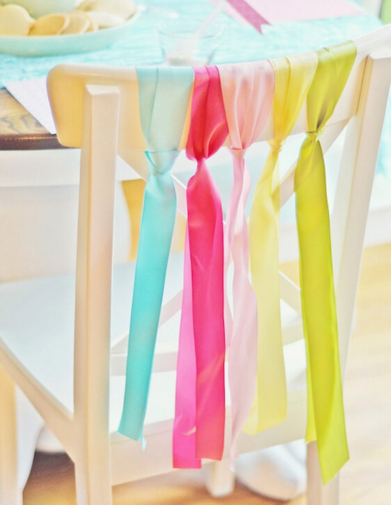 Colourful ribbons tied on wedding chair to add to marquee decoration