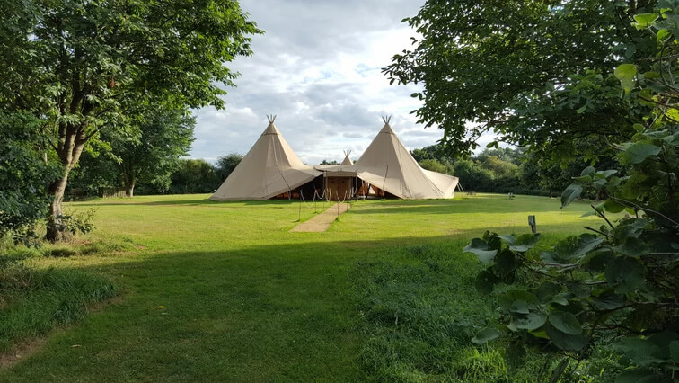 Wedding tipis set up in the grounds of Welford Park a stunning private estate for Berkshire Wedding Venues