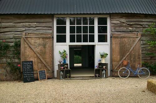 Rural rustic wedding set up at Templars Barn a countryside Berkshire Wedding Venue