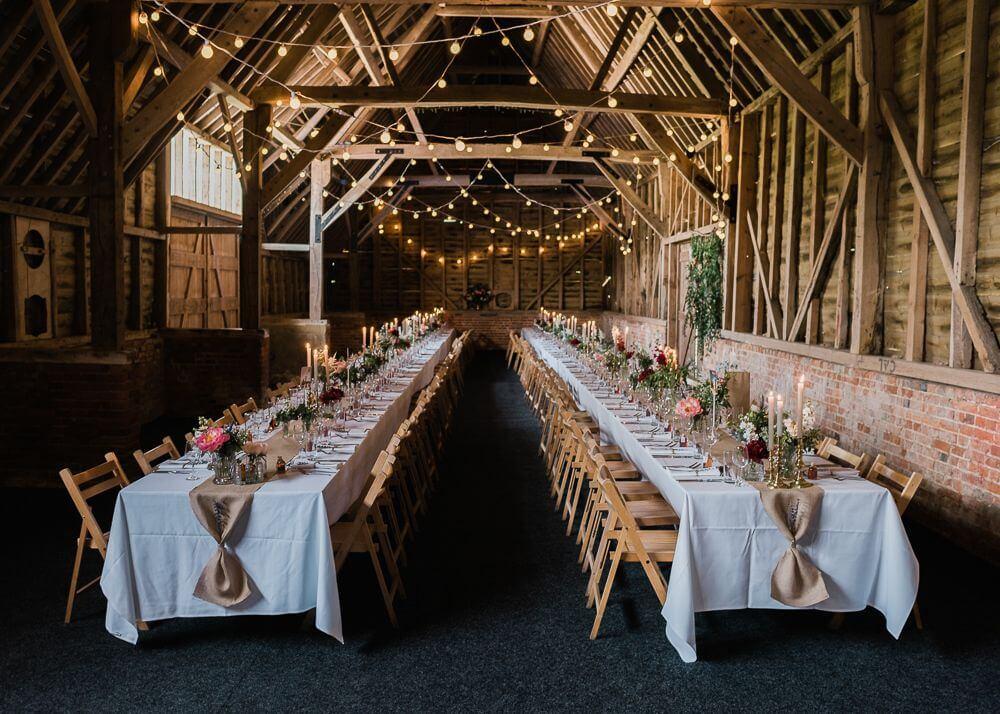 Wedding table and chairs inside North Hidden Barn a rustic Berkshire Wedding Venue